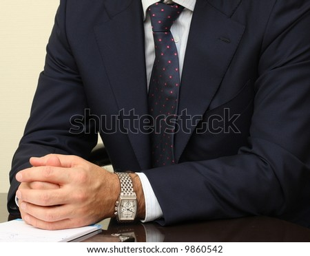Businessman's hands on the table - stock photo