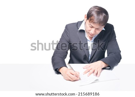 businessman's hands while writing some documents, - stock photo
