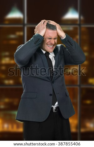 Businessman's headache at work. Adult man's night work problems. Everything is lost. The boss is terrified. - stock photo