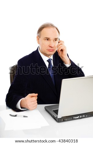 Businessman's working and speaking by phone