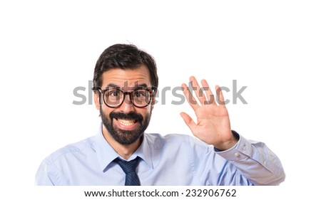 Businessman saluting over white background - stock photo