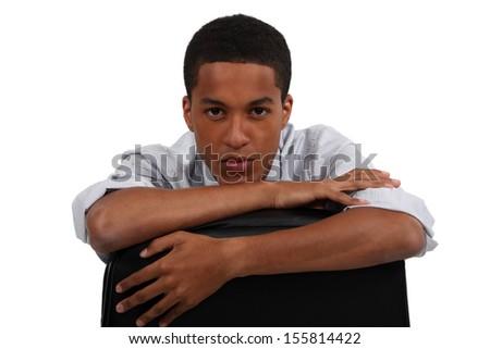 Businessman sat backwards on hair - stock photo