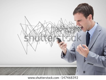 Businessman screaming and holding his mobile phone - stock photo