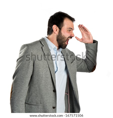 Businessman screaming over white background
