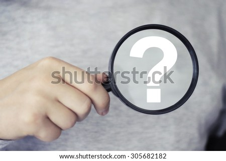 Businessman search loupe magnifier question icon - stock photo