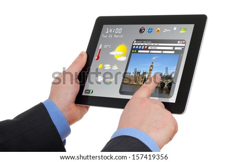 businessman searching a tourism information on touchscreen pad - stock photo