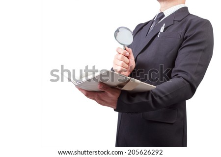 businessman searching information from the books by using magnifying on white background with clipping path - stock photo