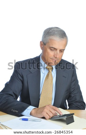 Businessman Seated at His Desk Using Calculator isolated on white