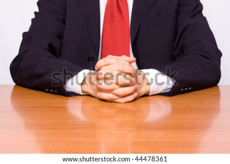 businessman seated at the table - stock photo
