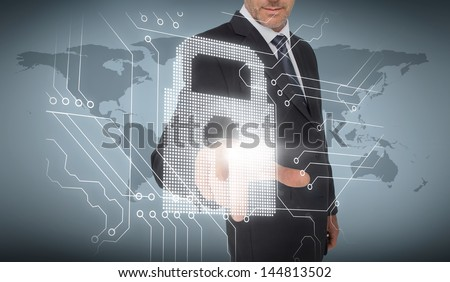 Businessman selecting a white padlock with world map on the background