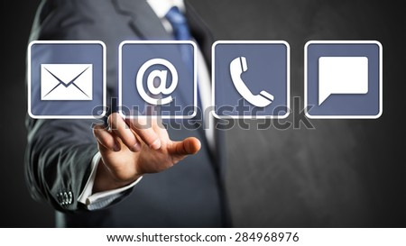 businessman selecting email as a contact option - stock photo