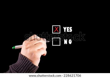 Businessman selects yes checkbox - stock photo