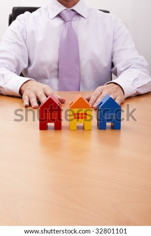 businessman selling a new house at his office (selective focus)