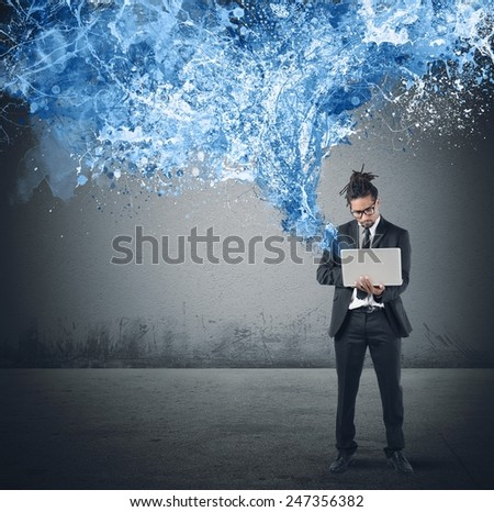 Businessman send and share with his laptop - stock photo