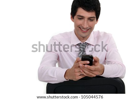 Businessman sending text message - stock photo