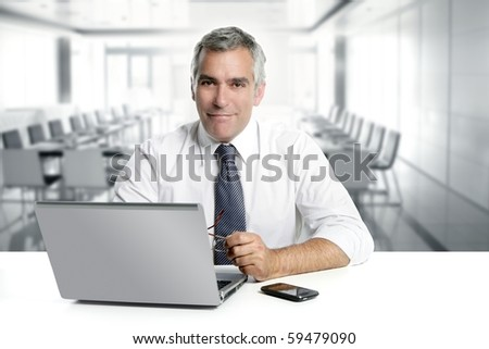 businessman senior gray hair working laptop interior modern white office - stock photo