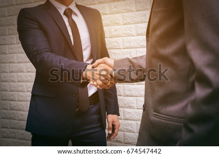 Businessman Shaking Hand After Finish Business Meeting in Conference Room