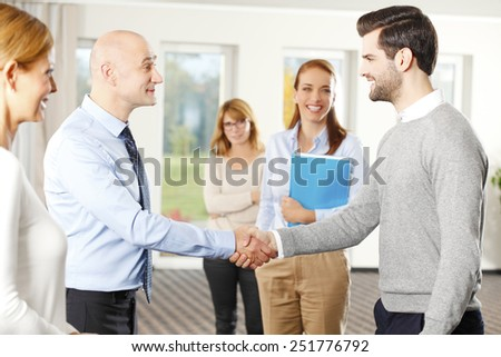 Businessman shaking hands at meeting. - stock photo