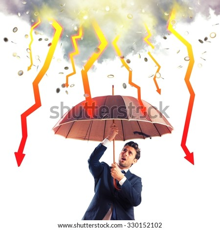 Businessman sheltered with umbrella from lightning arrow - stock photo