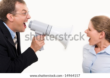 Businessman shouting by megaphone opposite screaming woman