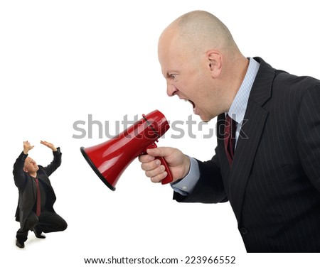 Businessman shouting orders at a worker isolated on a white background - stock photo