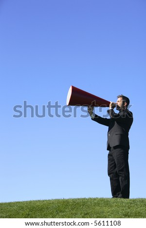 Businessman shouting through a megaphone - stock photo