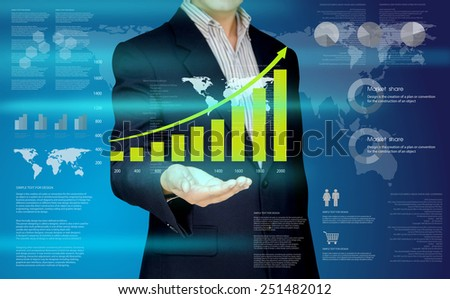 Businessman show the graph on hand, Design concept of Business and Information technology - stock photo
