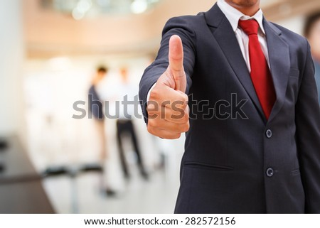 businessman show thumb up in office - stock photo