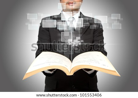 Businessman show virtual button from a book