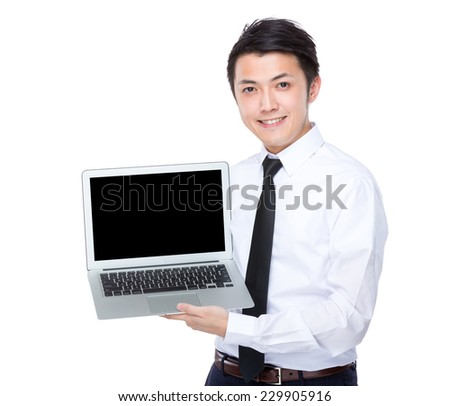 Businessman show with blank screen of laptop
