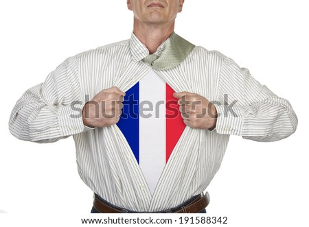 Businessman showing a superhero French suit underneath his shirt, clipping path for blank t-shirt - stock photo