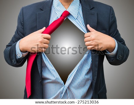 Businessman showing a superhero suit underneath his suit, isolated on white background. with clipping path and copyspace for your text - stock photo