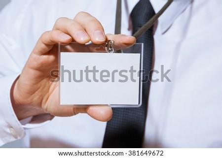 Businessman showing an empty business card, closeup shot - stock photo