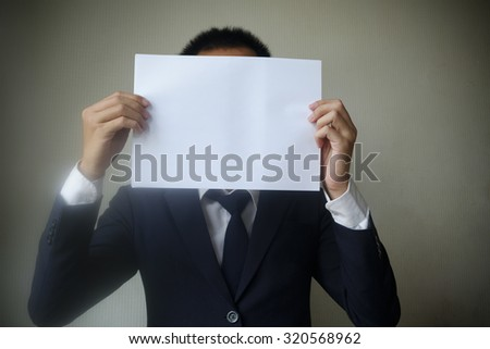Businessman showing  blank paper for you text , business idea concept