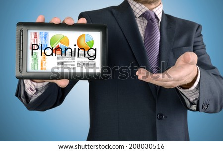 Businessman showing business concept on tablet - Planning