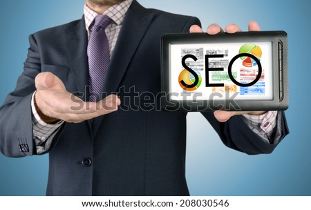 Businessman showing business concept on tablet - SEO