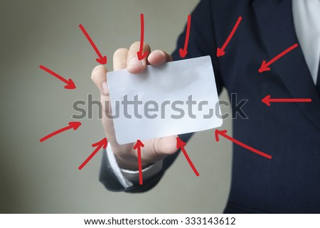 Businessman showing card blank with arrows  , business idea concept - stock photo