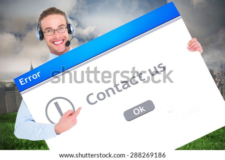 Businessman showing card wearing headset against contact us - stock photo