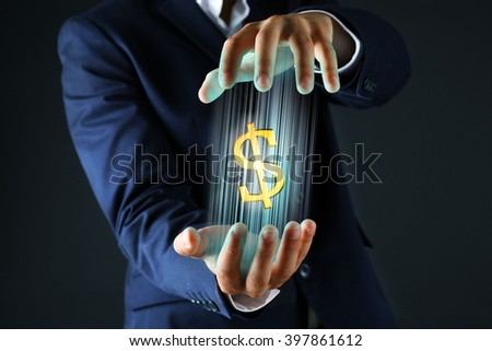 Businessman showing dollar sign in his hand, on dark background