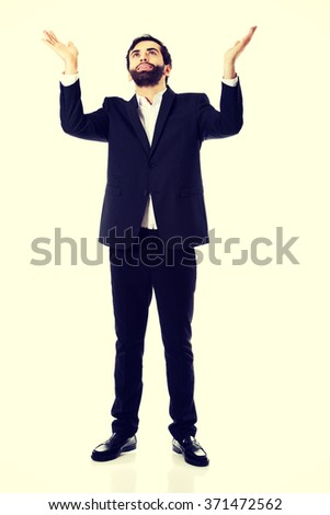 Businessman showing empty copyspace in hands. - stock photo