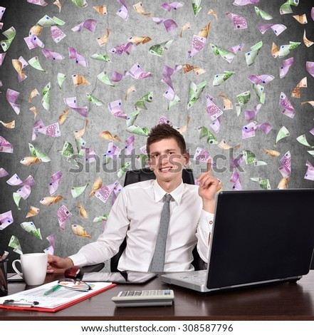 businessman showing finger up and falling dollars banknote - stock photo