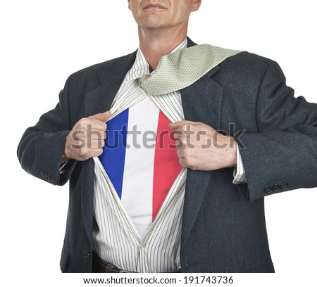 Businessman showing French flag superhero suit underneath his shirt standing against white background - stock photo