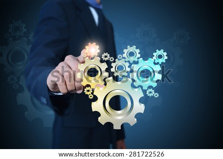 businessman showing gears cogs to success concept   - stock photo