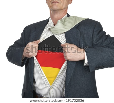 Businessman showing Germany flag superhero suit underneath his shirt standing against white background - stock photo