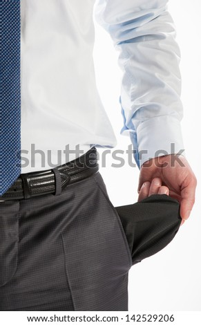 Businessman showing his empty pocket - closeup shot - stock photo