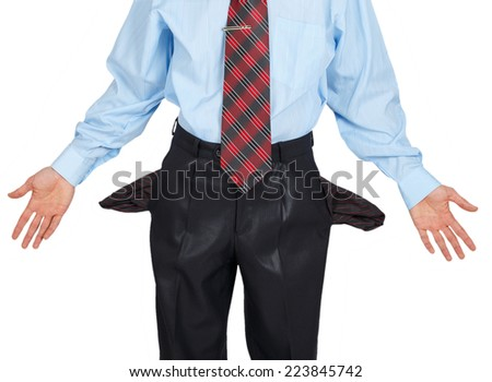 Businessman showing his empty pocket, turning his pocket inside out isolated on white background - stock photo