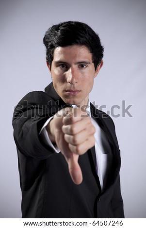 Businessman showing his rejection with his thumb down - stock photo