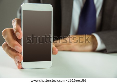 Businessman showing his smart phone in close up