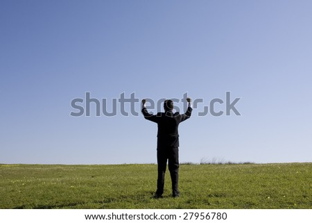 businessman showing his success at the field - stock photo