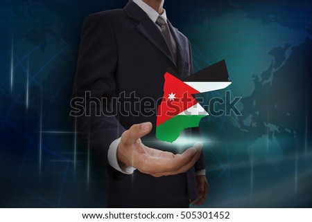 Businessman showing map of Jordan on globe background